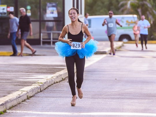 Cheysie Bates pushes herself to maintain her commanding lead during the Macy's 9th Annual High Heel-A-Thon at the Micronesia Mall on Saturday, Dec. 2, 2017. In the end, Bates was awarded for being the first female to complete the course.