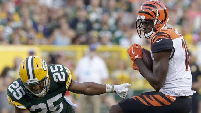 Cincinnati Bengals wide receiver A.J. Green picks up 18 yards on a reception after Green Bay Packers defensive back Marwin Evans misses a tackle during the fourth quarter.