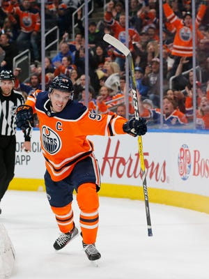 Edmonton Oilers forward Connor McDavid (97) celebrates a goal during a game against the Los Angeles Kings.
