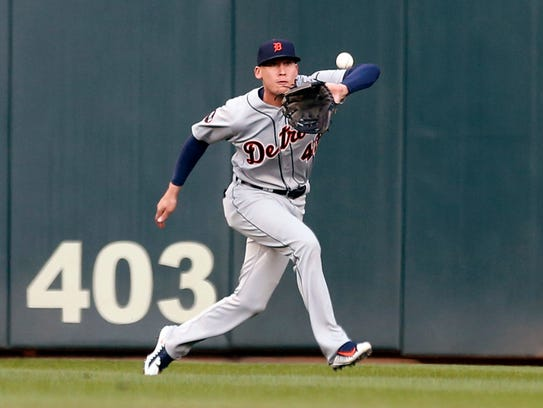 Tigers centerfielder JaCoby Jones eyes the ball hit
