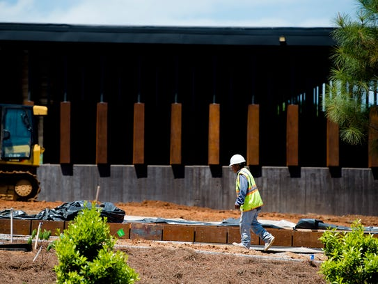 A construction worker walks outside Equal Justice Initiative's