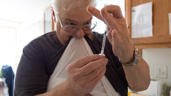 Gary Stumpf of Dover prepares a diabetes insulin shot. Stumpf has had diabetes for 20 years.