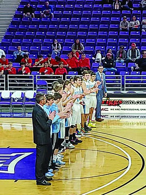 Members of the Skyline boys basketball team take part in the introduction ceremony at the state of there 1A State Basketball Tournament run last week Thursday. The tournament was cut short due to directives from KSHSAA and state-wide coronavirus concerns.