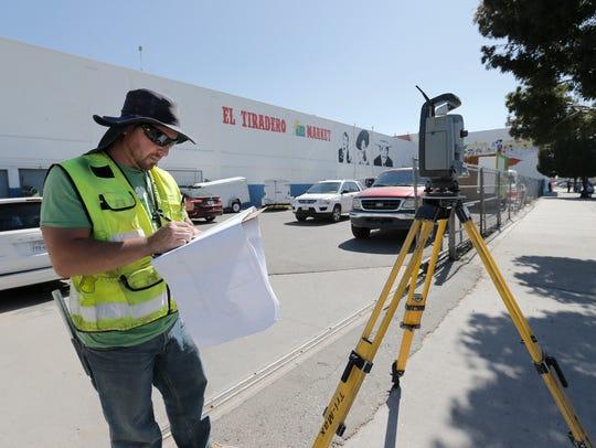 A surveyor recently charts the area on Chihuahua Street,