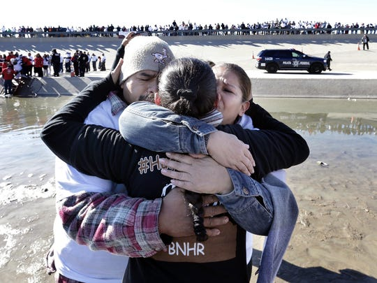 Aurora Caro, center, hugs Jesus Solis, left, who she hadn't seen in 21 years, and Gabriela Caro, who she hadn't seen in 11 years, during a past Hugs Not Walls event in the Rio Grande riverbed in South El Paso. The event, hosted by the Border Network for Human Rights, allowed families to reunite for just three minutes in the middle of the river near the Chihuahuita neighborhood.