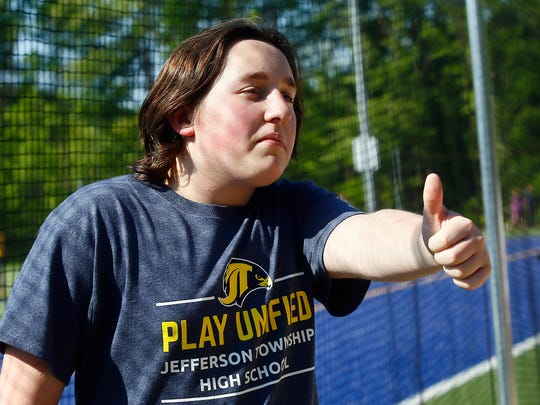 Jacob Luker of Jefferson flashes a thumbs up after getting cheers for his long jump during the NJAC Unified track and field meet at Jefferson Township High School . May 24, 2018. Randolph, NJ
