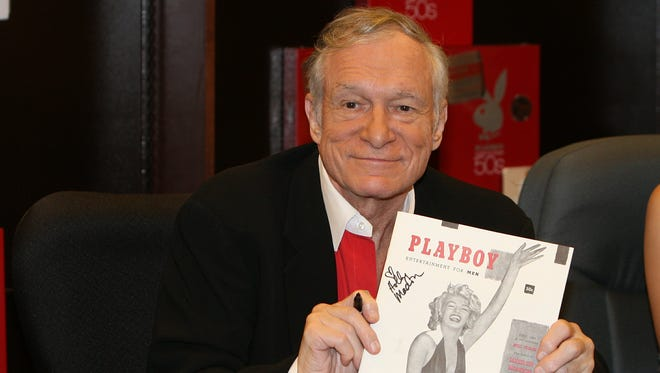 In this Nov. 15, 2007 photo, Hugh Hefner smiles while signing copies of the Playboy calendar and Playboy Cover To Cover: The 50's DVD box set in Los Angeles.