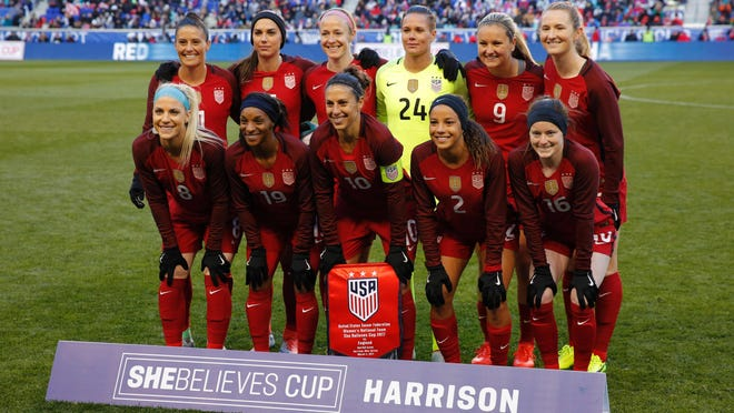 The United States starters pose for a group photo before the United States and England women's national teams play in the SheBelieves Cup in Harrison, NJ, on March 4, 2017. / AFP PHOTO / DOMINICK REUTERDOMINICK REUTER/AFP/Getty Images