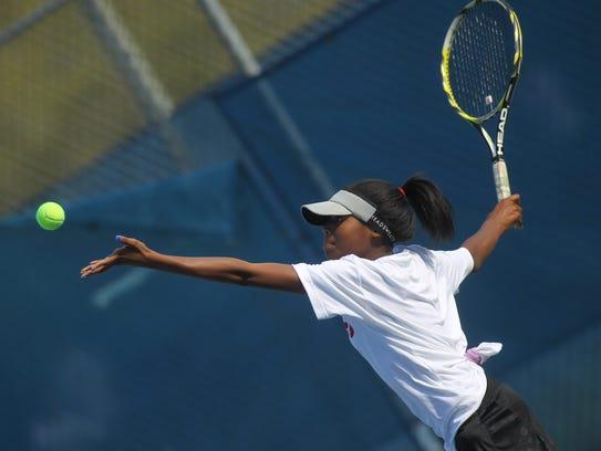 NFC eighth-grader Ashlynn Stennett serves during a