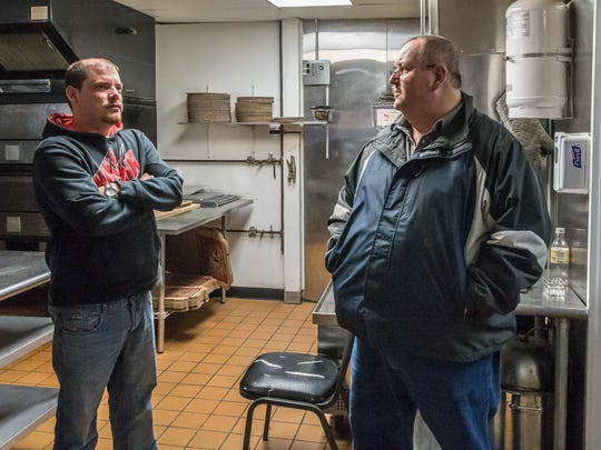 Battle Creek residents Marc Wixson (left) and Roy Grenier have purchased The Pizza Parlor and will reopen the restaurant next month.