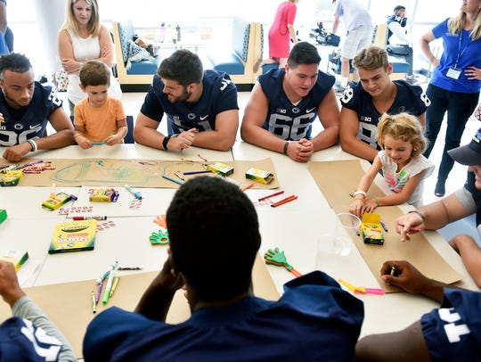Penn State football players color and interact with