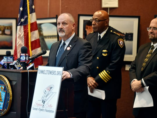 Frank Siller speaks at a news conference detailing fundraising efforts to support the family of slain Deputy U.S. Marshal Christopher Hill Friday, Jan. 19, 2018, in the Rev. Dr. Martin Luther King Jr. City Government Center in Harrisburg. Siller is chairman/CEO of the Stephen Siller Tunnel to Towers Foundation, a 9/11 nonprofit organization that provides financial aid to the families of law enforcement officers killed in the line of duty. The foundation is starting a campaign to pay off Hill's mortgage, and is donating the first $100,000.