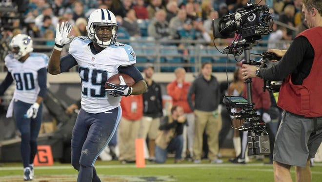 Titans running back and Jacksonville native Leon Washington waves to a cameraman after scoring a touchdown in the first quarter at Everbank Field.