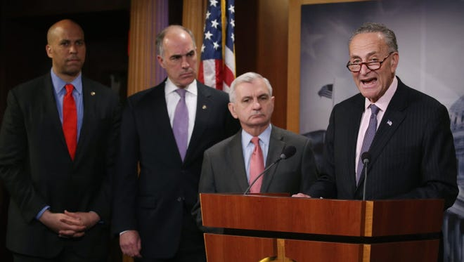 Sen. Charles Schumer, D-N.Y., speaks about Amtrak funding while flanked by Sens. Jack Reed, D-R.I., Bob Casey, D-Pa., and Cory Booker, D-N.J., during a news conference on Capitol Hill on May 21, 2015.