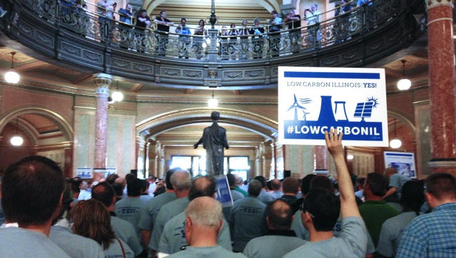Workers, union members and other supporters rally to provide a financial incentive for nuclear power and low-carbon emissions at the Illinois Capitol in Springfield on May 6, 2015.