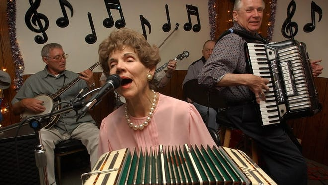"""Mildred """"Concertina Millie"""" Kaminski, shown performing in 2003 in Milwaukee, was a member of the Polka Hall of Fame and World Concertina Congress Hall of Fame. She died of natural causes Sept. 16."""