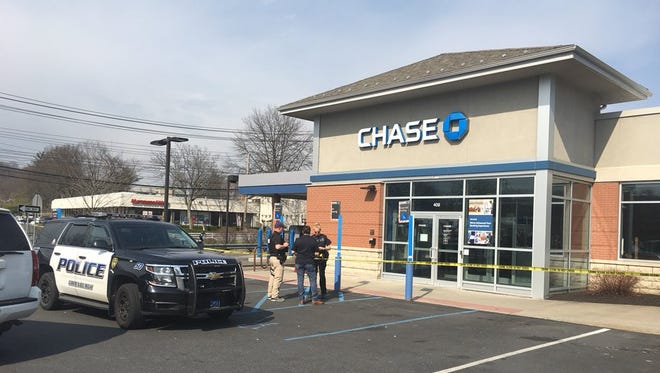 Police report to a bank robbery in Greenburgh April 14