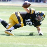 C.J. Beathard falls after accepting a bad shotgun snap from center Lucas LeGrand, an 8-yard loss on third-and-3 that killed a Hawkeye drive in the fourth quarter of Saturday's 23-21 loss to North Dakota State.