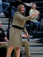 Winchester coach Holly Gutierrez reacts Saturday, Feb. 4, 2017, during the girls basketball sectional championship in Fountain City.