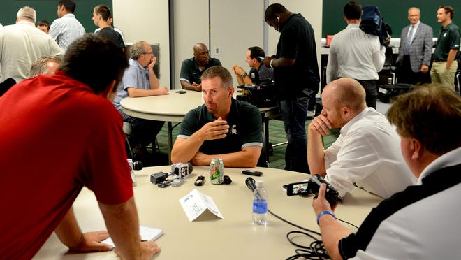 Michigan State co-defensive coordinator Mike Tressel talks to members of the media Monday, August 10, 2015, during Media Day for the football team at Spartan Stadium.