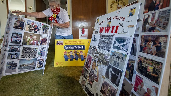 Mae Krier, 94, of Levittown, sorts through some of her Rosie the Riveter memorabilia.