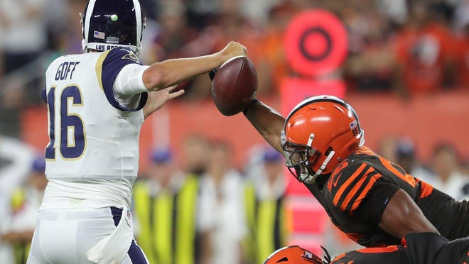 Browns defensive end Myles Garrett strips the ball from the hand of Los Angeles Rams quarterback Jared Goff during a game in September.