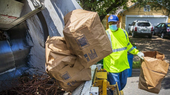 Austin Resource Recovery Damien Bailey-Harris runs his routes in northwest Austin as he picks up recycling on Wednesday, May 27, 2020. Trash, recycling, and compost have increased since the stay-at-home order was issued earlier this year.