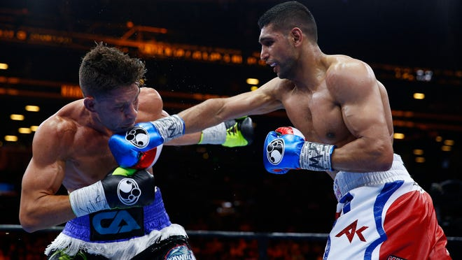 Amir Khan connects against Chris Algieri Friday. Khan won by ananimous decision and could fight Floyd Mayweather next. (Photo: Andrew Couldridge, Reuters)