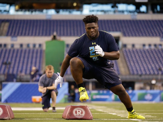 Wren High School product D.J. Jones runs through a drill at the NFL Scouting Combine on March 5.