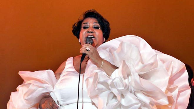Aretha Franklin performs at the Greek Theatre in Los Angeles in 2004.