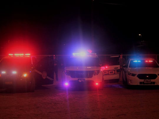 In this file photo, police lights and sirens light