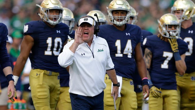 Notre Dame head coach Brian Kelly yells from the sideline during the first half of an NCAA college football game against the Georgia Tech in South Bend, Ind., Saturday, Sept. 19, 2015.