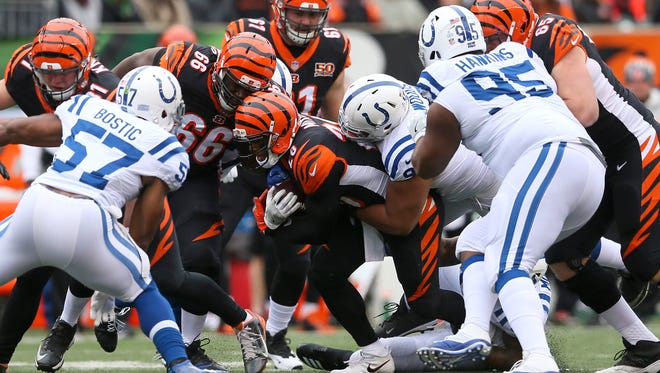 Cincinnati Bengals running back Joe Mixon (28) is tackled on a run in the first quarter during the Week 8 NFL game between the Indianapolis Colts and Cincinnati Bengals, Sunday, Oct. 29, 2017, at Paul Brown Stadium in Cincinnati.