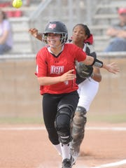 Abilene Cooper catcher Symone Gary throws to third while Lubbock Cooper runner Posey Pence is caught in a rundown in the second inning. Pence, who hit a two-run single in the inning, was thrown out at home trying to score on Callie Box's hit. Lubbock Cooper won the District 4-5A game 13-2 in five innings Friday, March 23, 2018 at Cougar Diamond.