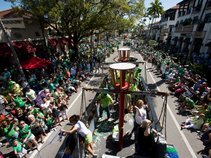 Thousands gather, adorned in green garb, for the annual