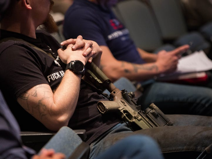 Gun rights activists, many armed with weapons entered