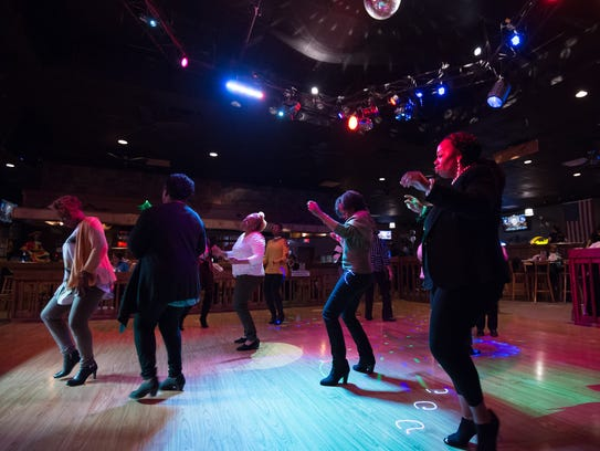 People dance to The Edge Band at The Boulevard Live Entertainment Restaurant in Dover.