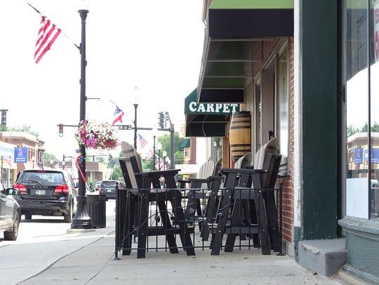 Whether storefront items on Bucyrus  sidewalks were