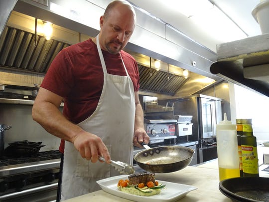 Chef Dan Bailey plates a meal at the 1938 Restaurant and Pub next to the Hide Away Country Inn in Bucyrus.