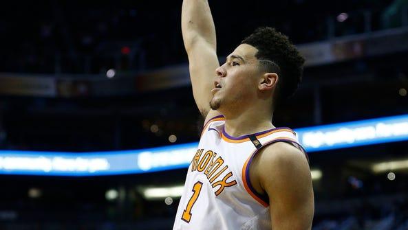 Phoenix Suns guard Devin Booker watches a 3-pointer
