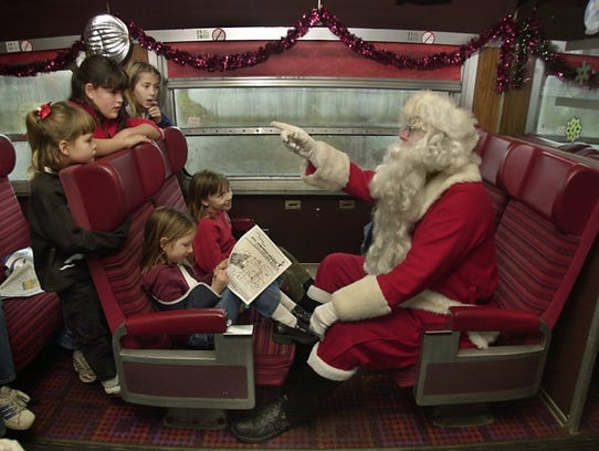 Santa Claus asks children what they want for Christmas during a Santa Train outing in 2002.