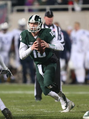 Michigan State Spartans Connor Cook passes against the Penn State Nittany Lions during second half action on Saturday , November 28, in East Lansing, Michigan.