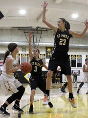 Alamogordo's Calysta Jacob, left, tries to find an open teammate while being defended by St. Pius' BryAnna Trujillo (3) and Arianna Martinez (23) on Friday night.