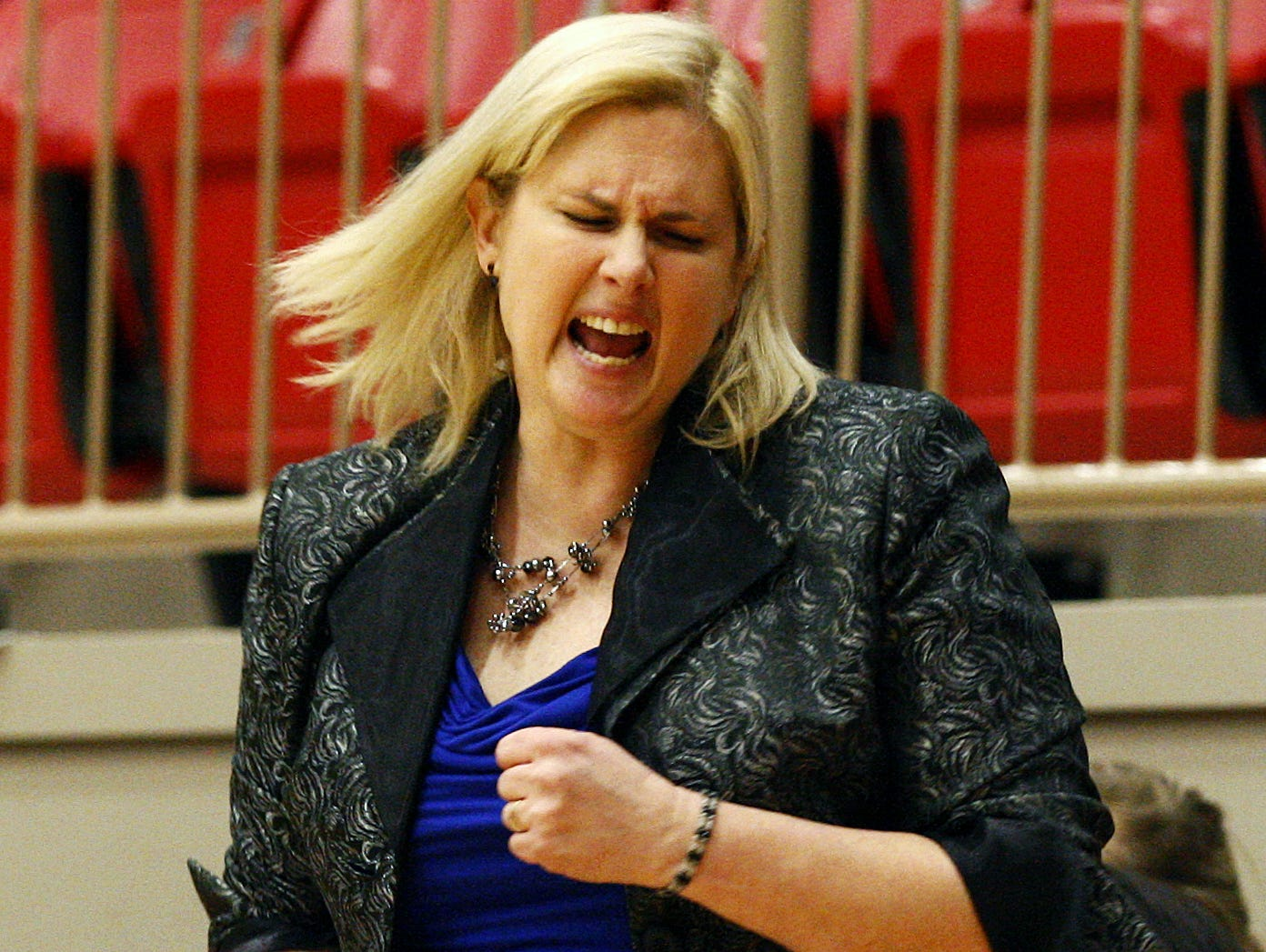 Hillcrest coach Jeni Hopkins celebrates during Hillcrest's victory over McDonald County in a Class 4 sectional at Branson in 2015
