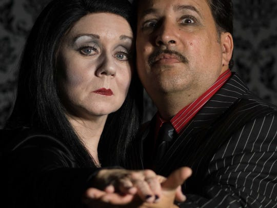 "Kathleen Clarke-Horrigan and Michael Davis star as Morticia and Gomez Addams in ""The Addams Family."""