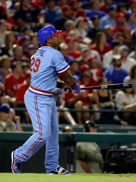Texas Rangers' Adrian Beltre watches his two-run home run during the third inning of the team's baseball game against the Los Angeles Angels on Saturday, July 8, 2017, in Arlington, Texas. (AP Photo/Tony Gutierrez)