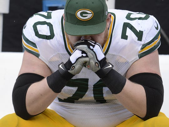 Green Bay Packers guard T.J. Lang (70) shows his dejection