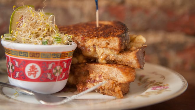 The King of Sandwich: An Elvis sandwich (peanut butter, bananas, bacon, and honey) is served on multigrain bread, with vegan potato salad at Red Hook in Philadelphia.