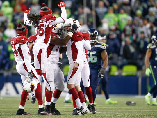 Arizona kicker Chandler Catanzaro (right) celebrates his winning field goal as time expired against Seattle.