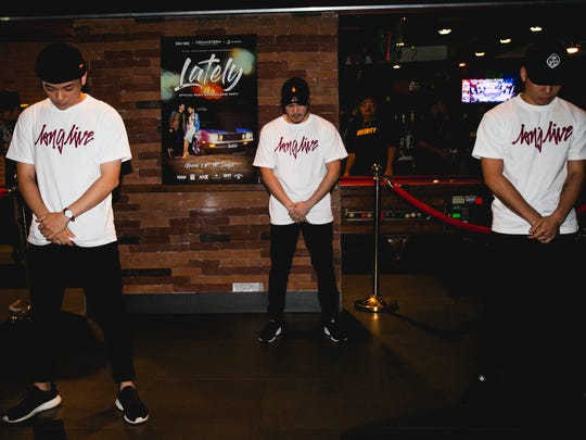 """From left, Leo De Asis, Adrian Calugay and JJ Cruz perform at Brix in Tumon for the release of the music video for """"Lately"""" by local singer Jed Antonio."""